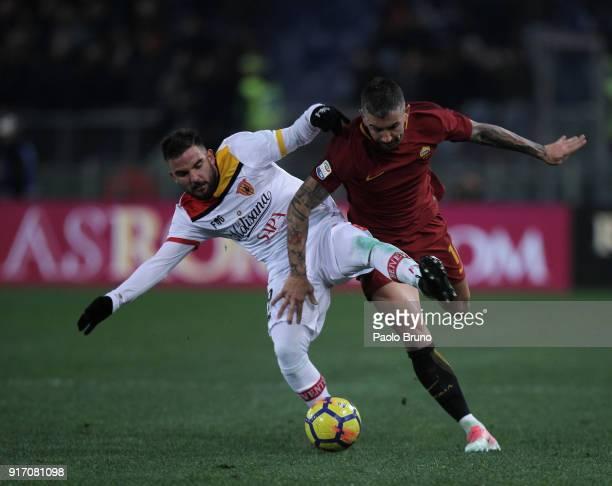Enrico Brignola of Benevento Calcio competes for the ball with Aleksandar Kolarov of AS Roma during the serie A match between AS Roma and Benevento...