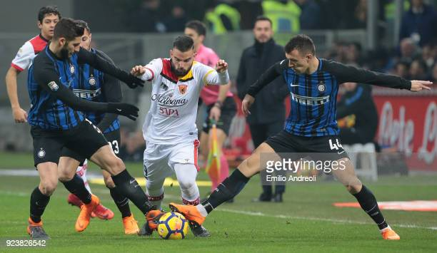 Enrico Brignola of Benevento Calcio is challenged by Roberto Gagliardini and Ivan Perisic of FC Internazionale Milano during the serie A match...