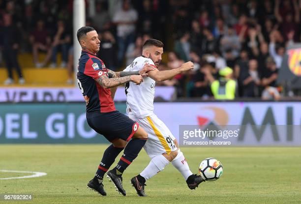 Enrico Brignola of Benevento Calcio vies with Armando Izzo of Genoa CFC during the serie A match between Benevento Calcio and Genoa CFC at Stadio...