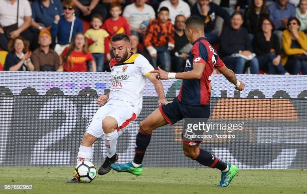 Enrico Brignola of Benevento Calcio vies with Jawad El Jamiq of Genoa CFC during the serie A match between Benevento Calcio and Genoa CFC at Stadio...