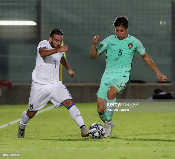 Enrico Brignola of Italy competes for the ball with Moura of Portugal during the match beteween Italy U20 v Portugal U20 on October 16 2018 in...