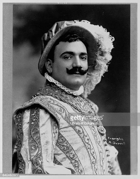 Enrico Caruso Italian opera singer wears a embroidered theatrical costume and feathered hat