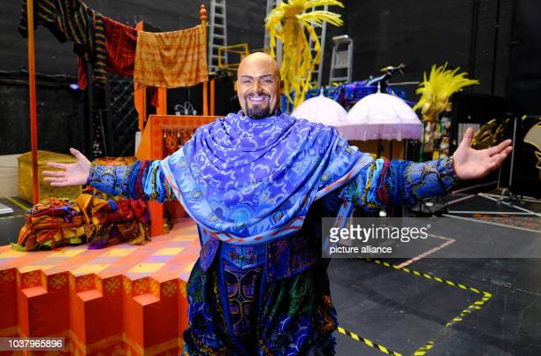 Enrico De Pieri as the 'Genie' of the 'Aladdin' musical poses in front of the backdrop at the Neue Flora theatre in Hamburg Germany 1 December 2016...