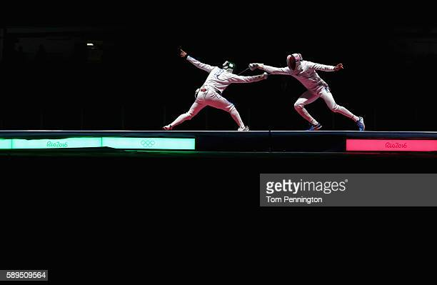 Enrico Garozzo of Italy competes against JeanMichel Luceney of France during the Men's Epee Team Gold Medal Match on Day 9 of the Rio 2016 Olympic...
