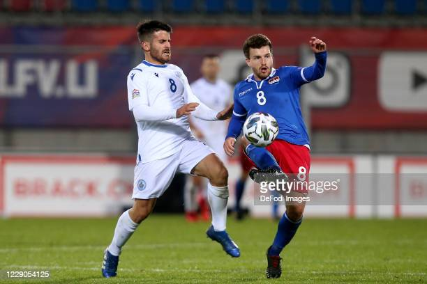 Enrico Golinucci of San Marino and Aron Sele of Liechtenstein battle for the ball during the UEFA Nations League group stage match between...