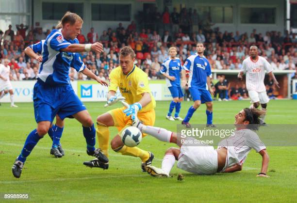 Enrico Kern and Alexander Walke of Rostock battles for the ball with Huezeyfe Dogan of Berlin during the Second Bundesliga match between 1. FC Union...