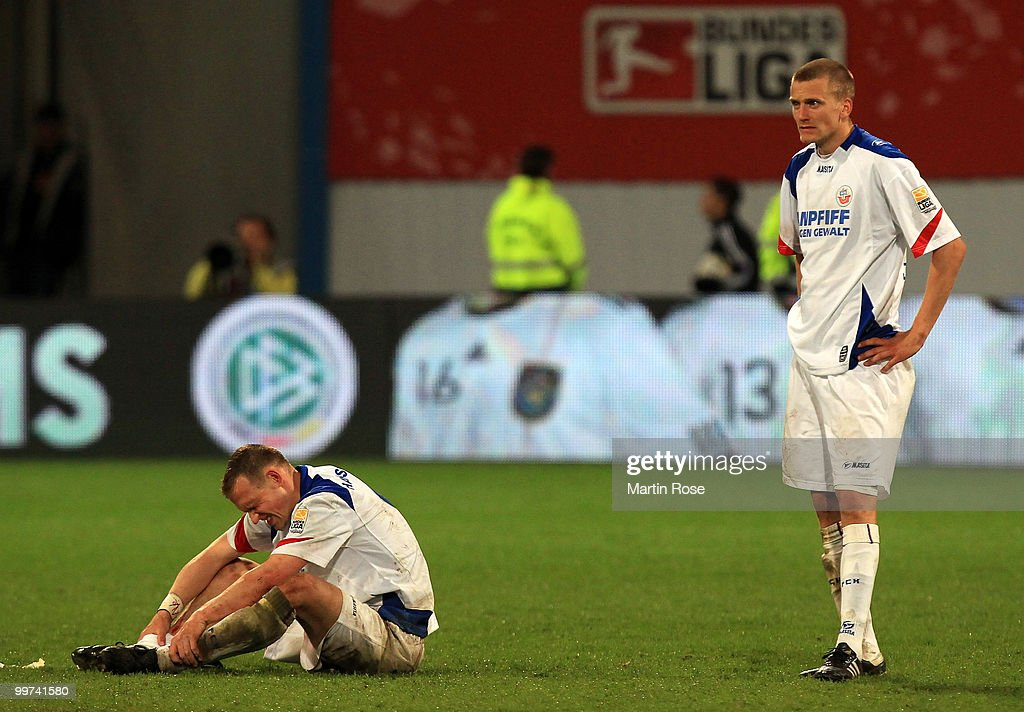 Enrico Kern (L) and Andreas Dahlen (R) of Rostock look dejected after the Second Bundesliga play off leg two match between Hansa Rostock and FC Ingolstadt 04 at DKB Arena on May 17, 2010 in Rostock, Germany. Hansa Rostock go down to the Third Bundesliga.