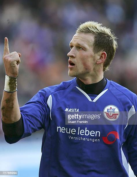 Enrico Kern of Rostock celebrates scoring his goal during the Second Bundesliga match between Hansa Rostock and 1860 Munich at the Ostsee stadium on...