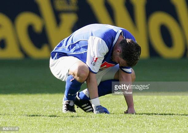 Enrico Kern of Rostock looks dejected after the Bundesliga match between Hansa Rostock and Hamburger SV at the DKB Arena on May 3 2008 in Rostock...