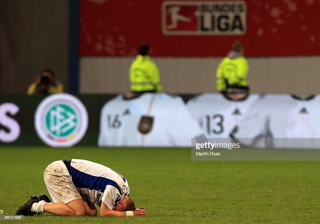 Enrico Kern of Rostock looks dejected after the Second Bundesliga play off leg two match between Hansa Rostock and FC Ingolstadt 04 at DKB Arena on May 17, 2010 in Rostock, Germany. Hansa Rostock go down to the Third Bundesliga.