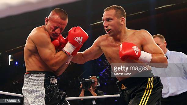 Enrico Koelling of Germany exchanges punches with Haris Causevic of Austria during their light heavyweight fight at Sport und Kongresshalle on August...