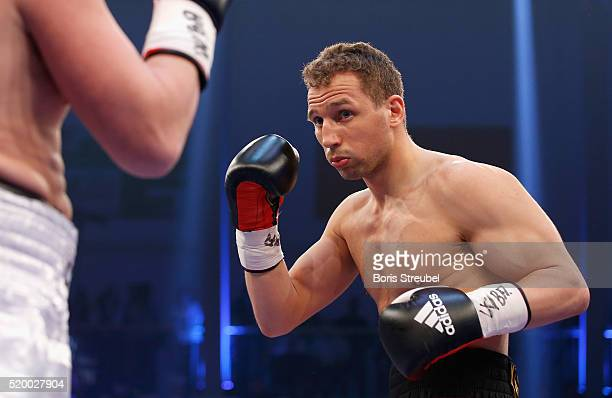Enrico Koelling of Germany exchanges punches with Oleksandr Cherviak of Ukraine during their WBA intercontinental light heavyweight championship...