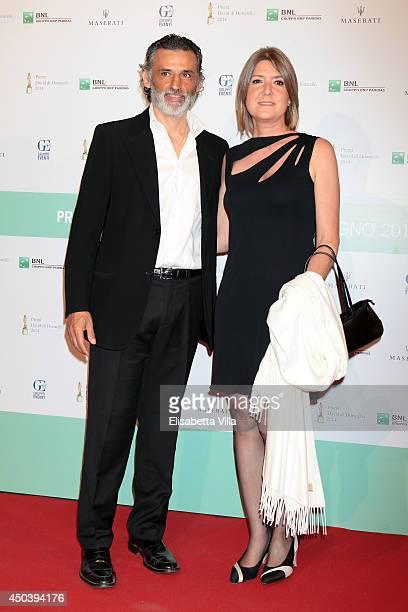Enrico Lo Verso and wife attend the David Di Donatello Awards Ceremony at the Dear Studios on June 10 2014 in Rome Italy
