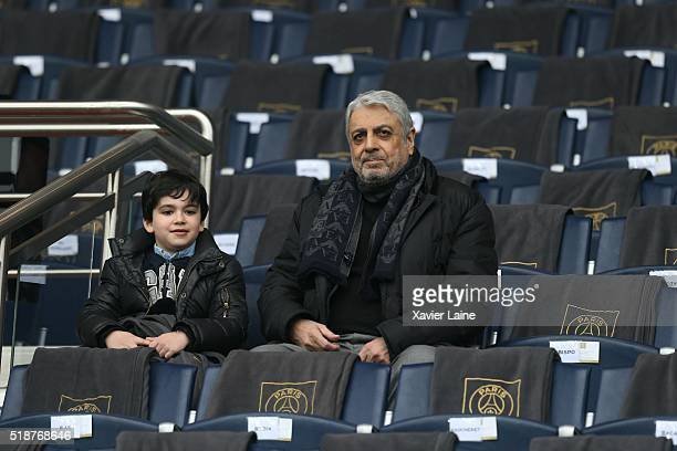 Enrico Macias and his grandson attend the French Ligue 1 match between Paris SaintGermain and OGC Nice at Parc des Princes on april 02 2016 in Paris...