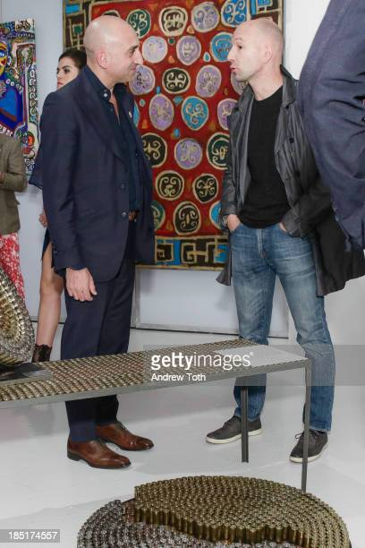 Enrico Pedico and Artist Massimuano Bolzoneua attend the Clen Gallery Art Exhibition at Rogue Space on October 17 2013 in New York City