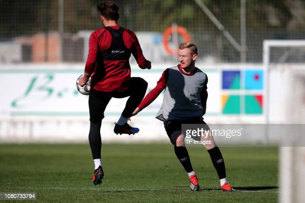 Enrico Valentini of 1. FC Nuernberg and Sebastian Kerk of 1. FC Nuernberg battle for the ball during a training session as part of the 1. FC...