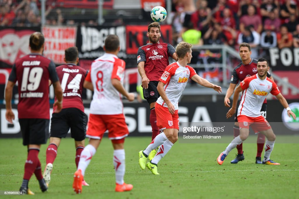 Enrico Valentini of 1. FC Nuernberg goes for a header during the Second Bundesliga match between SSV Jahn Regensburg and 1. FC Nuernberg at Continental Arena on August 6, 2017 in Regensburg, Germany.