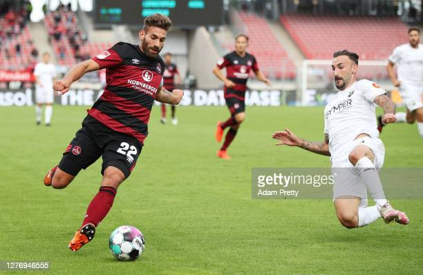 Enrico Valentini of 1. FC Nuernberg is challenged by Diego Contento of SV Sandhausen during the Second Bundesliga match between 1. FC Nürnberg and SV...
