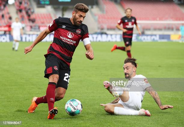Enrico Valentini of 1 FC Nuernberg is challenged by Diego Contento of SV Sandhausen during the Second Bundesliga match between 1 FC Nürnberg and SV...
