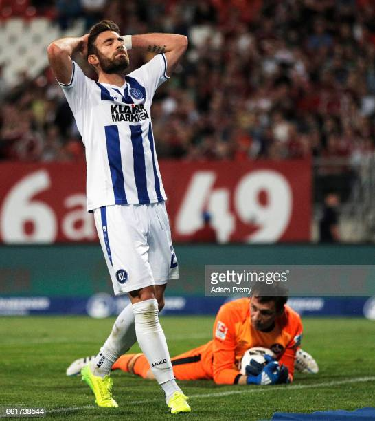 Enrico Valentini of Karlsruher SC is dejected after having a good chance at a goal saved by Raphael Schaefer of 1FC Nuernbergduring the Second...
