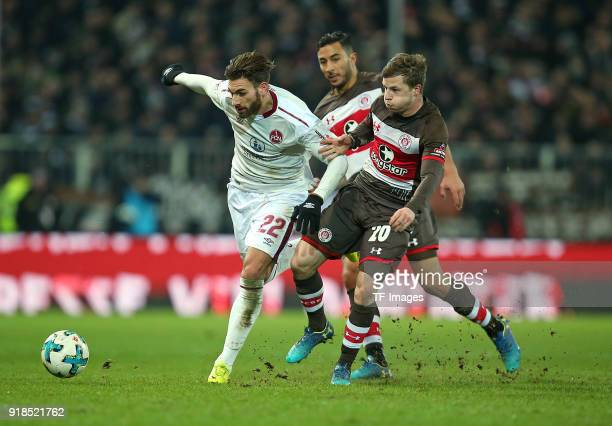 Enrico Valentini of Nuernberg and Aziz Bouhaddouz of St Pauli and Richard Neudecker of St Pauli battle for the ball during the Second Bundesliga...