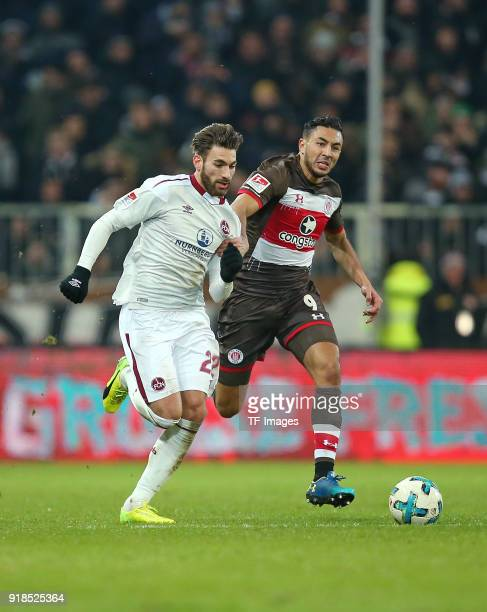 Enrico Valentini of Nuernberg and Aziz Bouhaddouz of St Pauli battle for the ball during the Second Bundesliga match between FC St Pauli and 1 FC...
