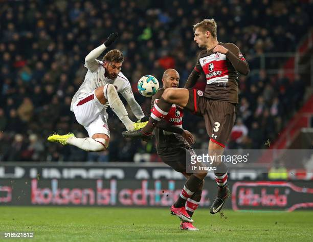 Enrico Valentini of Nuernberg and Christopher Avevor of St Pauli and Lasse Sobiech of St Pauli battle for the ball during the Second Bundesliga match...