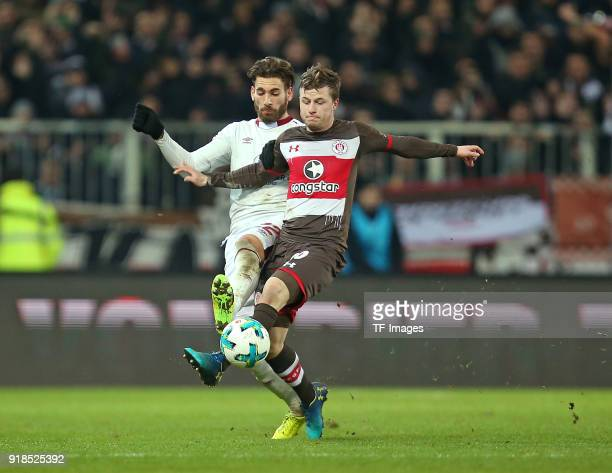 Enrico Valentini of Nuernberg and Richard Neudecker of St Pauli battle for the ball during the Second Bundesliga match between FC St Pauli and 1 FC...