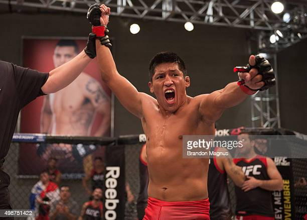 Enrique Barzola celebrates his victory over Cesar Arsamendia in their semifinals fight during the filming of The Ultimate Fighter Latin America Team...