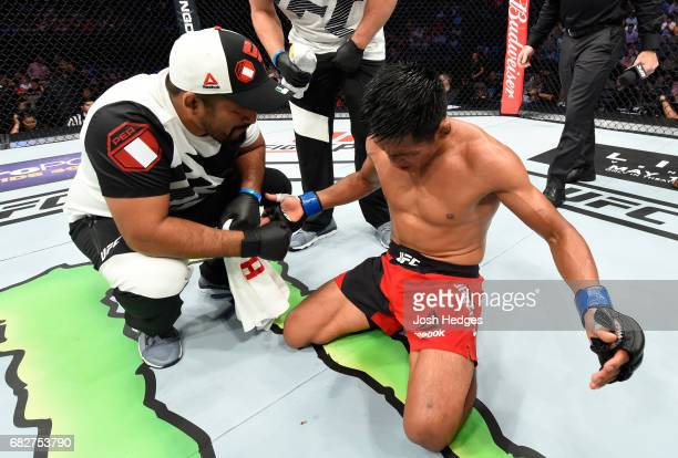Enrique Barzola celebrates his victory over Gabriel Benitez in their featherweight fight during the UFC 211 event at the American Airlines Center on...