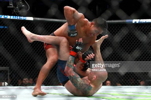 Enrique Barzola grapples with Matt Bessette in their Flyweight fight during UFC 220 at TD Garden on January 20 2018 in Boston Massachusetts