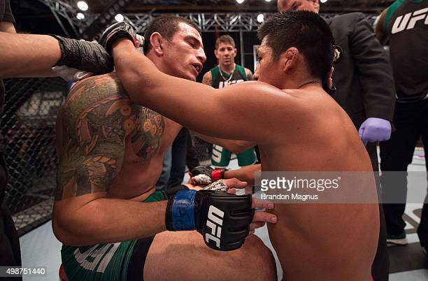 Enrique Barzola hugs Cesar Arsamendia after their semifinals fight during the filming of The Ultimate Fighter Latin America Team Gastelum vs Team...