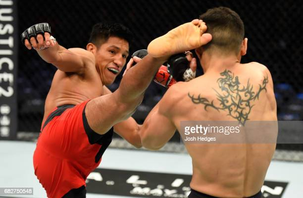 Enrique Barzola kicks Gabriel Benitez in their featherweight fight during the UFC 211 event at the American Airlines Center on May 13 2017 in Dallas...