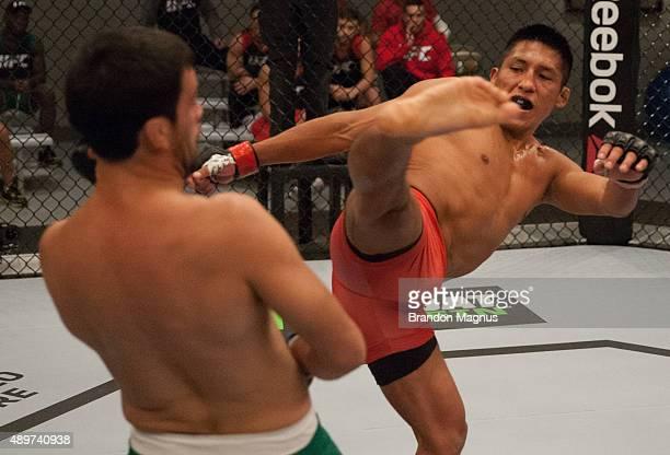 Enrique Barzola kicks Jonathan Ortega during the filming of The Ultimate Fighter Latin America Team Gastelum vs Team Escudero on April 7 2015 in Las...