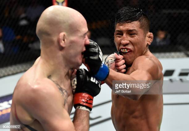 Enrique Barzola of Peru and Matt Bessette trade punches in their featherweight bout during the UFC 220 event at TD Garden on January 20 2018 in...