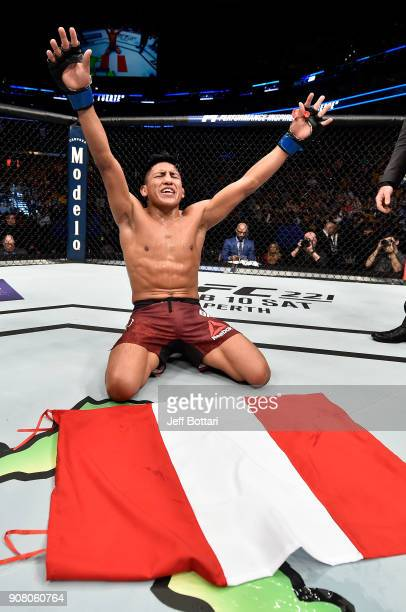 Enrique Barzola of Peru celebrates after his unanimousdecision victory over Matt Bessette in their featherweight bout during the UFC 220 event at TD...