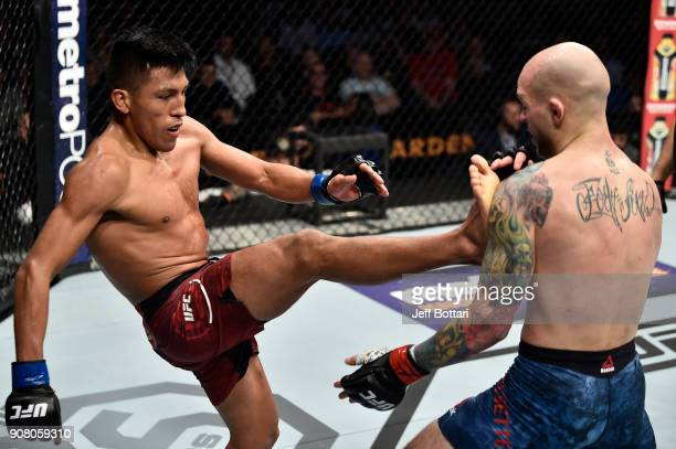 Enrique Barzola of Peru kicks Matt Bessette in their featherweight bout during the UFC 220 event at TD Garden on January 20 2018 in Boston...