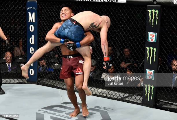 Enrique Barzola of Peru prepares to take down Matt Bessette in their featherweight bout during the UFC 220 event at TD Garden on January 20 2018 in...