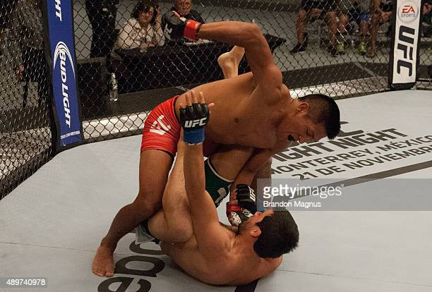 Enrique Barzola punches Jonathan Ortega during the filming of The Ultimate Fighter Latin America Team Gastelum vs Team Escudero on April 7 2015 in...