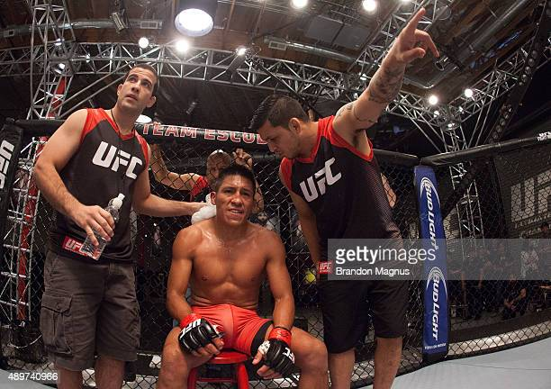 Enrique Barzola receives advice from his corner while facing Jonathan Ortega during the filming of The Ultimate Fighter Latin America Team Gastelum...