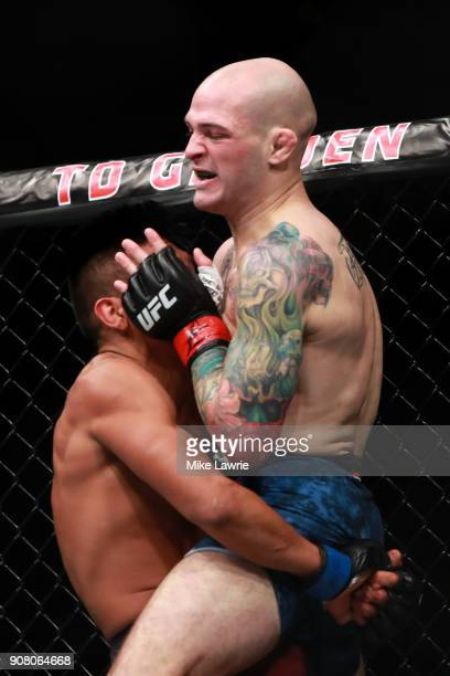Enrique Barzola takes down Matt Bessette in their Flyweight fight during UFC 220 at TD Garden on January 20 2018 in Boston Massachusetts