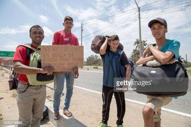 Enrique Bravo Yolfrank Colmenarez Jose Cordoba and Luis Alejos of Yaracuy Venezuela walk along the Panamericana route towards Lima on August 16 2018...