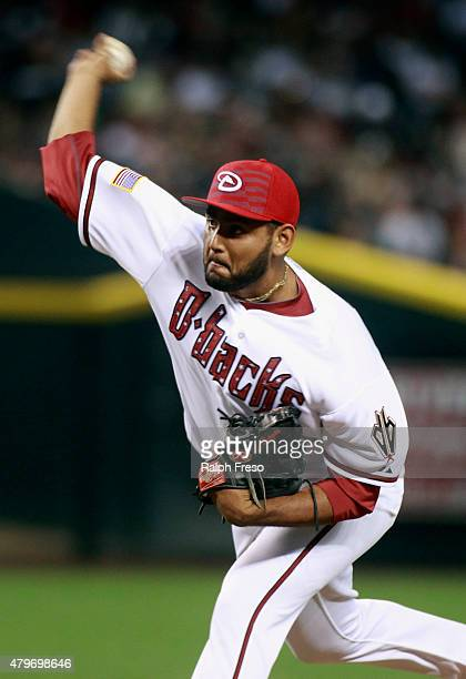 Enrique Burgos of the Arizona Diamondbacks delivers a pitch against the Colorado Rockies during the seventh inning of a MLB game at Chase Field on...