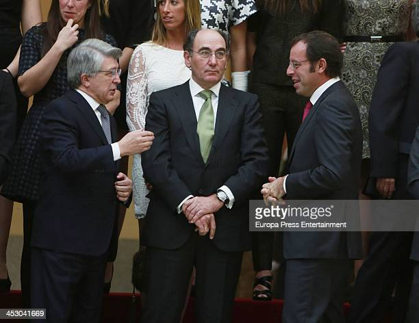 Enrique Cerezo Jose Ignacio Sanchez Galan and Sandro Rosell attend the National Sports Awards ceremony at El Pardo Palace on December 2 2013 in...