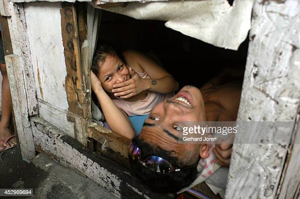 Enrique De La Torre and his girlfriend Mary Joyce Camacho rest in their tiny cell in the Manila City Jail. He is a member of Sputnik gang, one of 4...