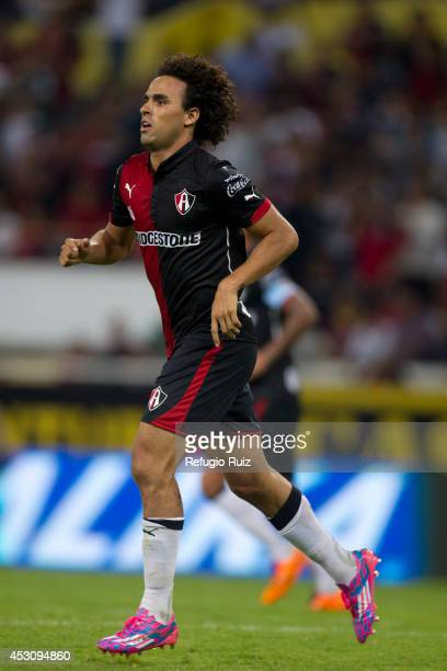 Enrique Esqueda of Atlas celebrates his goal during a match between Atlas and Chiapas as part of 3rd round Apertura 2014 Liga MX at Jalisco Stadium...