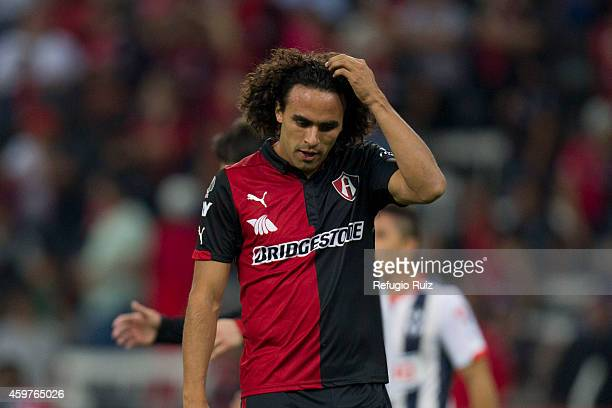 Enrique Ezqueda of Atlas looks dejected after losing the game between Atlas and Monterrey as part of the Apertura 2014 Liga MX at Jalisco Stadium on...