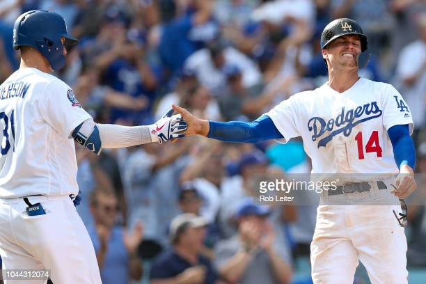 Enrique Hernandez celebrates with Joc Pederson of the Los Angeles Dodgers after scoring a run during the sixth inning against the Colorado Rockies at...