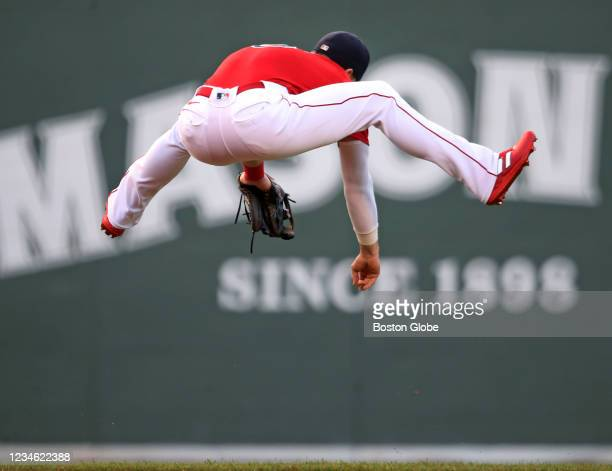 Enrique Hernandez leaps, but can't make the play on the top of the first inning, as the first pitch of the game, hit by the Rays lead off hitter...