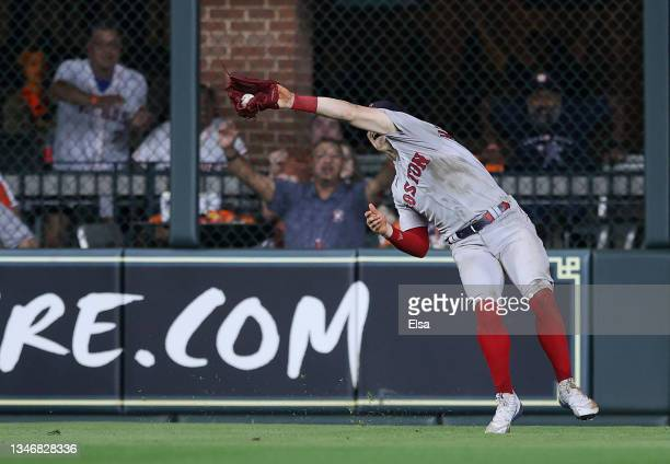 Enrique Hernandez of the Boston Red Sox catches ball hit by Kyle Tucker of the Houston Astros for the final out of the fifth inning during Game One...